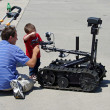 McGUIRE AIR FORE BASE-WRIGHTSTOWN, NEW JERSEY, USA-MAY 12: A man is shown explaining to a young boy how a remote controlled robot works during the base's Open House held on May 12, 2012. — Stock Photo