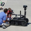 McGUIRE AIR FORE BASE-WRIGHTSTOWN, NEW JERSEY, USA-MAY 12: Two young boys are seen inspecting a remote controlled robot during the base's Open House held on May 12, 2012. — Stock Photo