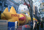 NEW YORK-NOV 21: On the day before the 2012 Macy's Thanksgiving Day Parade, all of the giant balloons are inflated with helium. Pictured here are the Hello Kitty and Macy's Star balloons. — Stock Photo