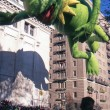 Stock Photo: NEW YORK-NOV 22: A holiday tradition since 1924, the annual Macy's Thanksgiving Day Parade is seen by more than 3.5 million people. Pictured here in 2012 is the Kermit the Frog balloon.