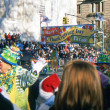 NEW YORK-NOV 22: A holiday tradition since 1924, the annual Macy's Thanksgiving Day Parade is seen by more than 3.5 million people. The start of the 2012 parade is pictured. — Stock Photo #34161545