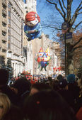 NEW YORK-NOV 22: A holiday tradition since 1924, the annual Macy's Thanksgiving Day Parade is seen by more than 3.5 million people. Pictured here in 2012 are the Virginia and Elves balloons. — Stock Photo