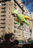 NEW YORK-NOV 22: A holiday tradition since 1924, the annual Macy's Thanksgiving Day Parade is seen by more than 3.5 million people. Pictured here in 2012 is the Rex the Happy Flying Dragon balloon. — Stok fotoğraf