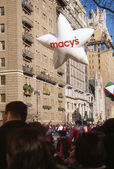 NEW YORK-NOV 22: A holiday tradition since 1924, the annual Macy's Thanksgiving Day Parade is seen by more than 3.5 million people. Pictured here in 2012 is the Macy's White Star balloon. — Stock Photo