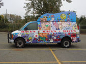 EAST RUTHERFORD, NJ, USA-OCT 5: The 2013 Macy's Thanksgiving Day Parade balloon handlers training session took place this year at MetLife Stadium. Pictured is a van used for parade advertisement. — Stock Photo