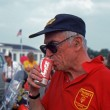 Stock Photo: READINGTON, NEW JERSEY, USA-JULY 21: Malcolm Forbes, owner and publisher of FORBES business magazine enjoys cof Coca-Colat 1985 New Jersey Festival of Hot Air Ballooning at Solberg Airport.