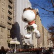 NEW YORK-NOV 24: A holiday tradition since 1924, the annual Macy's Thanksgiving Day Parade is seen by more than 3.5 million people. Pictured here in 2011 is Snoopy, as a World War I flying ace. — Stock Photo