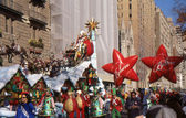 NEW YORK-NOV 24: A holiday tradition since 1924, the annual Macy's Thanksgiving Day Parade is seen by more than 3.5 million people. Pictured here in 2011 is Santa Claus, at the end of the parade. — Stock Photo