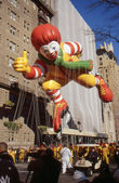 NEW YORK-NOV 24: A holiday tradition since 1924, the annual Macy's Thanksgiving Day Parade is seen by more than 3.5 million people. Pictured here in 2011 is an ice skating Ronald McDonald. — Stock Photo