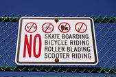 "SANDY HOOK, NEW JERSEY, USA-MAY 19: A sign stating ""NO SKATE BOARDING, BICYCLE RIDING, ROLLER BLADING, SCOOTER RIDING"" WAS PHOTOGRAPHED IN 2014. — Stock Photo"