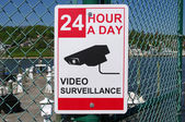 "SANDY HOOK, NEW JERSEY, USA-MAY 19: A security sign stating ""24 hour a day video surveillance"" was photographed at a boat marina in 2014. — Stock Photo"