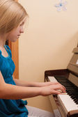 Girl playing piano — Stock Photo