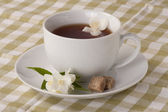 Jasmine tea and olive-green tablecloth — Stock Photo