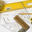 Stock Photo: Tools over house plan