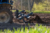 Tractor plowing field — Stock Photo
