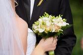 Wedding bouquet in hand — Stock Photo