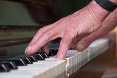 Senior man playing piano — Stock Photo