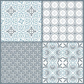 Set of four vintage decorative symmetric seamless patterns — Stock Vector