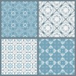 Set of four vintage symmetric seamless patterns — Stock Vector