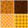 Halloween seamless patterns. Set of four — Stock Vector