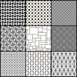 Set of nine black and white geometric seamless patterns — Stock Vector