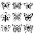 Butterflies, black silhouettes on white background — Stock Vector #44202157