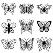 Butterflies, black silhouettes on white background — Stock Vector