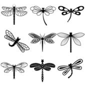 Dragonflies, black silhouettes on white background — Stock Vector