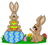 Easter bunnies playing with easter eggs — Stock Vector