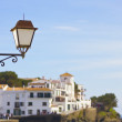 View of the town of Cadaques with lamp — Stock Photo