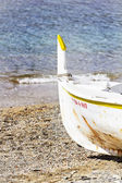 Anchored boat beached — Stock Photo