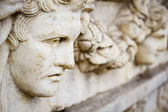Old greek face sculpture — Stock Photo