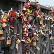 Love locks in a bridge — Stock Photo