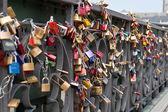 Love locks in a bridge — Stock Photo