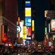Crowds at Times Square urban night scene — Stock Photo