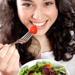 Happy girl eating salad — Foto de Stock