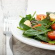 Salad of spinach  and tomato cherry. — Stock Photo