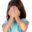 Little girl covering her face with her hands — Stock Photo