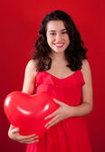 Girl and Red Heart Shaped Ballon — Stock Photo