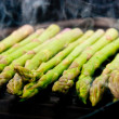 Grilling asparagus - Stock Photo