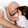 Father and daughter playing in bed in the morning — Stock Photo #21724371