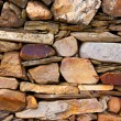 Stock Photo: Irregular stone low wall