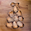 Christmas tree made with cookie cutters on a wooden table. — Stock Photo