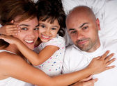 Embraced family in bed — Stock Photo