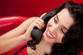 Young woman talking on retro phone — Stock Photo