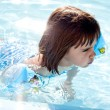 Stockfoto: Little girl swimming in pool
