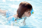 Little girl swimming in a pool — Stock Photo