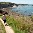 Child walking on path over sea. — Stock Photo #24770355
