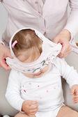 T-shirt over babys head — Stock Photo
