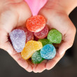 Jelly candy in child hands — Stock Photo #25401959